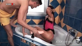 Slut-gets-ass-filled-with-huge-dildo-in-bathroom