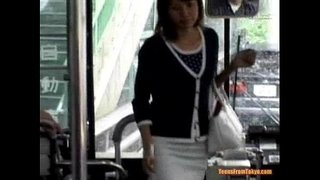 A-young-Asian-girl-enters-a-public-bus-and-sits-down-from-http://alljapanese.net