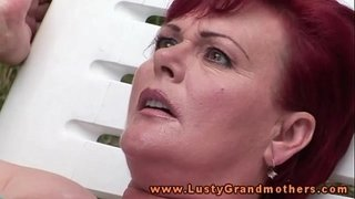 Ginger-mature-granny-fingered-outdoors
