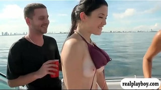 Two-sexy-girls-enjoyed-foursome-action-on-speed-boat