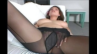 Busty-brunette-MILF-teases-in-black-pantyhose