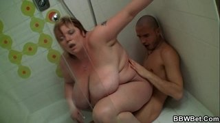 Huge-titted-lady-rides-in-the-shower
