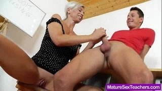 Blond-haired-Madam-giving-a-blowjob
