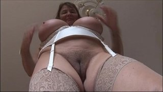 Busty-mature-brunette-with-huge-boobs-and-hairy-pussy-strips