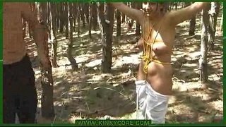 Bound-young-girl-tortured-with-nettle-in-the-forest