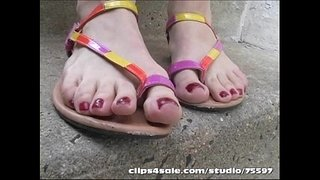 Hot-blonde-takes-sandals-off-in-Public