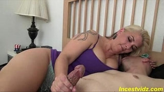 Hot-busty-mother-gives-her-son-a-slow-masturbation