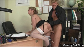 Office-mature-in-white-stockings-seduces-him