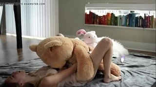 Petite-young-blonde-riding-a-teddy---evilcams.net